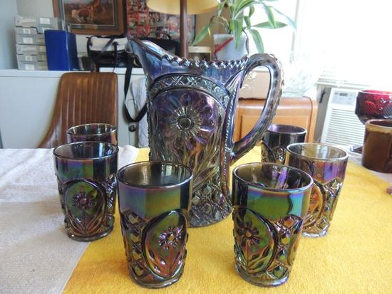 Blue carnival glass pitcher withsix glasses