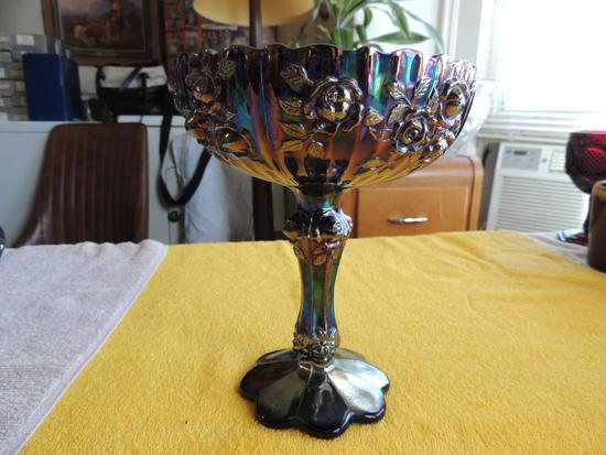 Blue carnival glass compote style candy dish with Roses pattern