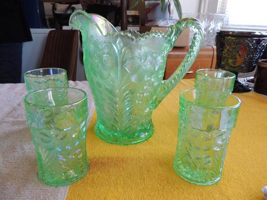 Mint green pitcher with four glasses