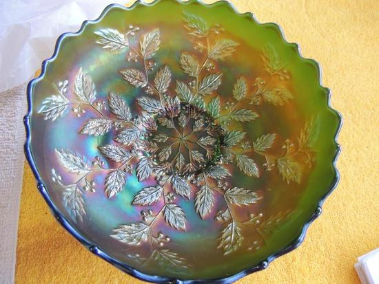 Green carnival glass bowl with leaf pattern