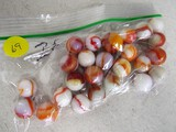 25 red/white swirl marbles