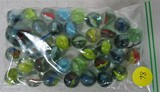 38 various colored swirl marbles