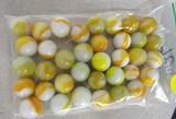36 yellow/orange/white marbles