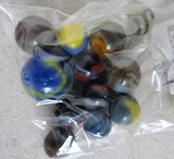 12 various size marbles