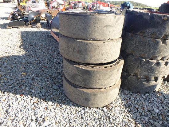 (4) 31x10.20 solid tires w/rims (QEA 5191)