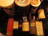 1193. Box full of Old Antique Bottles & Tins, including a large