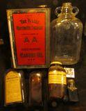1195. (5) Old Medicine Bottles including an embossed glass
