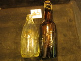 1198. Pair of Old Bottles, one clear glass with fluting to top half, other Amber with wire
