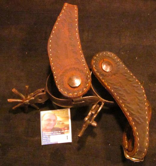 Pair of Hand forged and engraved Western Spurs. Little damage to the leather. Spurs work fine.