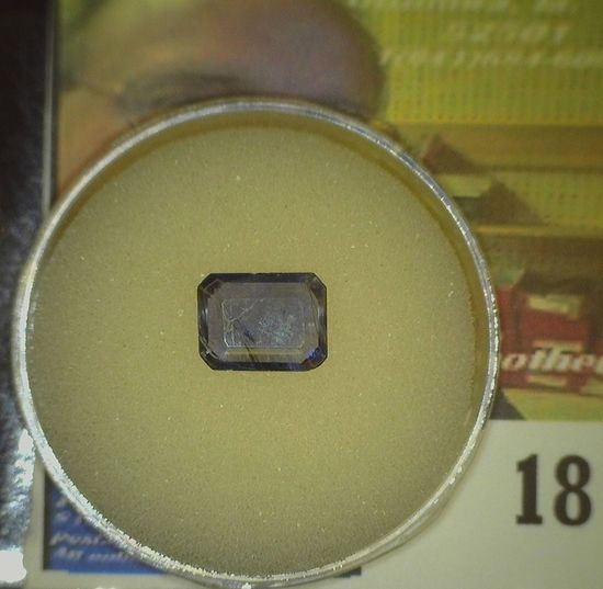 Rectangular faceted Precious Iolite Gem weighing 1.54 carats and ready to be mounted in a piece of j
