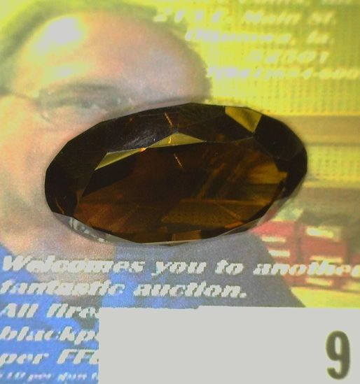 Oval faceted Precious Smokey Topaz weighing 47.12 carats and ready for mounting. Excellent color and
