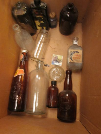 Wide Mouth Gallon Mason Jar and various old Medicine Bottles. Needs to be picked up, no shipping.