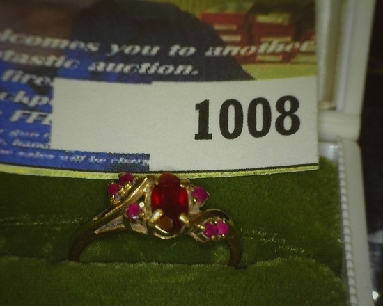10K Gold Ladies Ring five Red Sets, which appear to be Rubies. Size 7. Weighs 2.5 grams. No box.