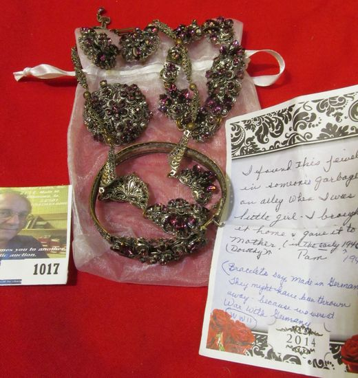 Earrings, Necklace, pair of Bracelets, and a Broach with Amethyst colored Stones. Note from Pamela H
