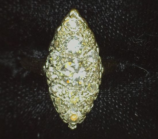 Ladies Size 7 Marquis shaped Diamond Ring with 19 Mine Cut Diamonds with graduated sizes up to appro