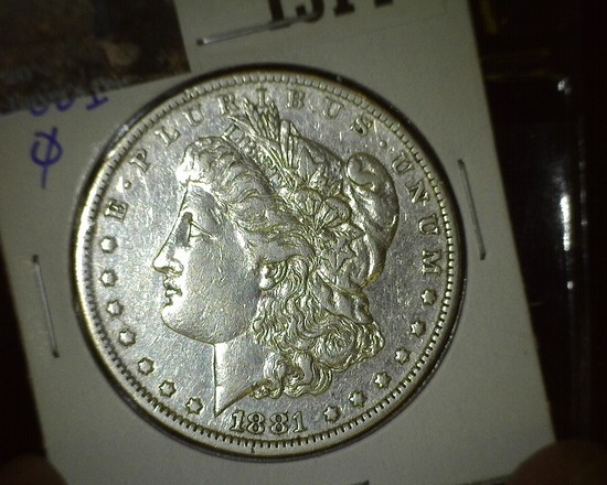 1881 O Morgan Silver Dollar with a lot of flash.