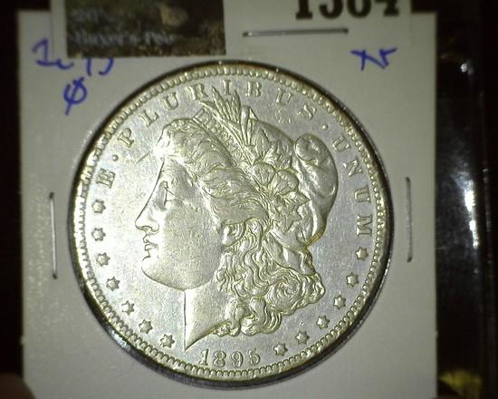 1895 O Key date Morgan Silver Dollar with a few rim ticks.