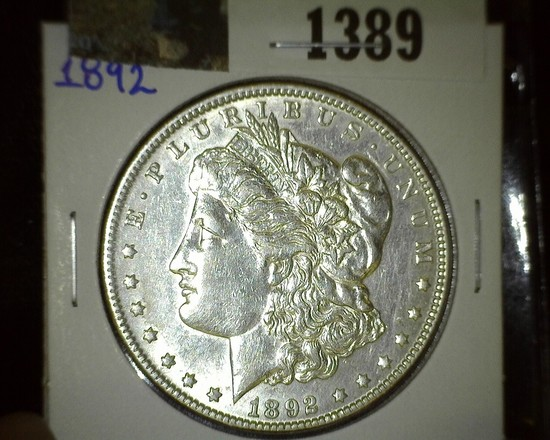 1892 P Morgan Silver Dollar, very scarce and quite flashy.