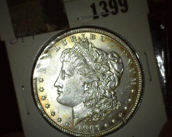 1897 P Morgan Silver Dollar, Brilliant Unc with a hint of toning.