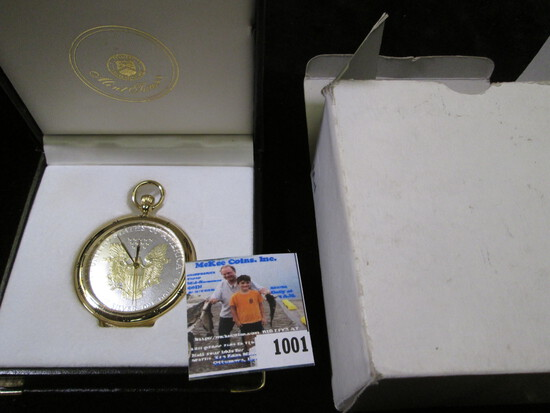 Gold-highlighted Silver American Eagle Dollar Pocket Watch, in original box. Not running, most likel