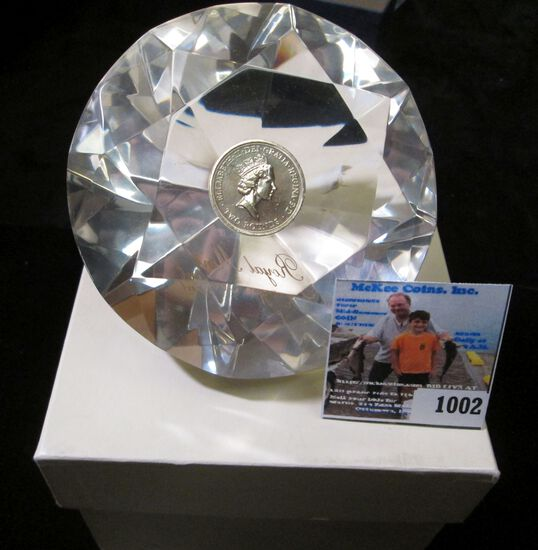 Large Diamond shaped Lucite Paperweight with a Great Britain Two Pound Sterling Coin embedded in the