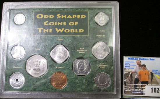 Nine odd-shaped Coins of the World in a hard plastic case. Most BU.