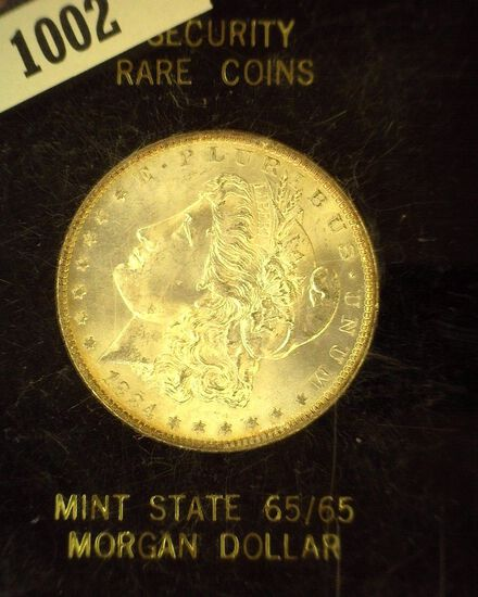 1884 O Morgan Silver Dollar, Slabbed by Security Rare Coins Mint State 65/65.