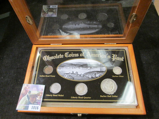 """Cased Set of """"Obsolete Coins of America's Past"""", five-piece."""