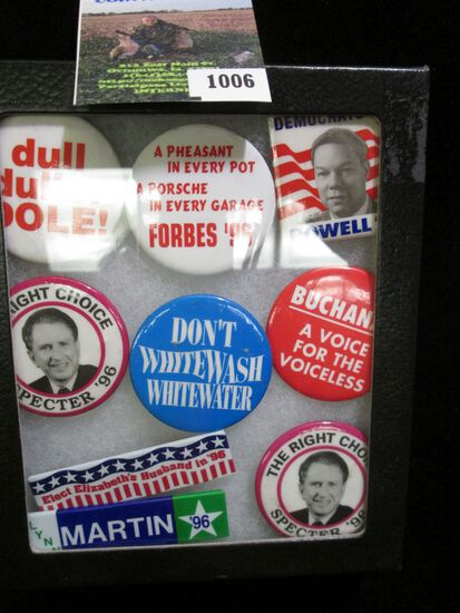 Set of nine Political Pin-backs in a glass case.