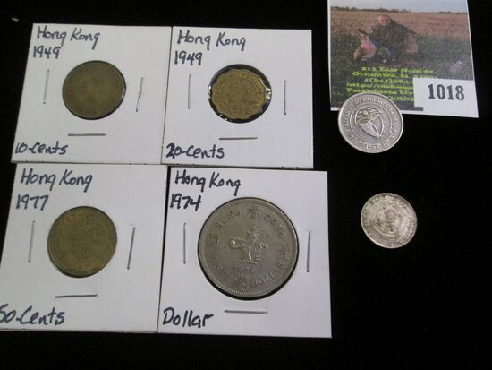 Four-piece Hong Kong Type set of coins and a pair of Foreign coins.