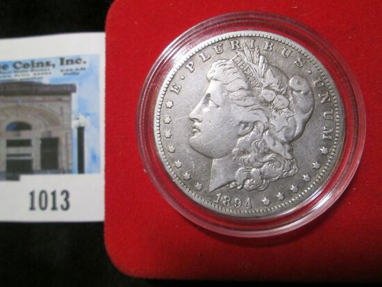 1894 O Morgan Silver Dollar in velvet-lined box with C.O.A.