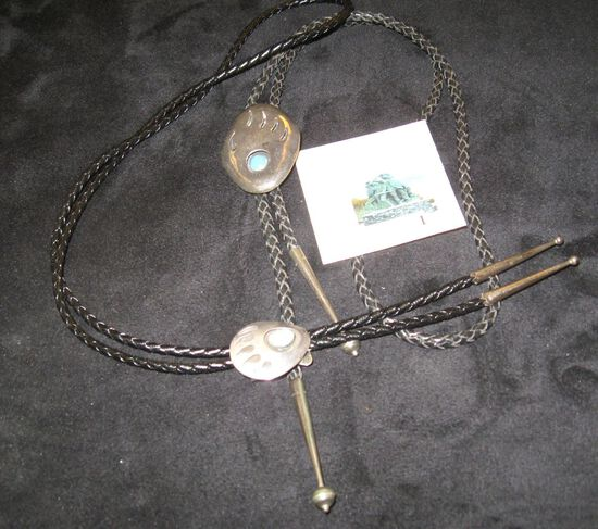Pair of sterling and turquoise bolo ties, Native American Indian with bear claw design, large signed