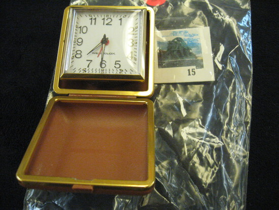 Westclox mechanical travel alarm clock, pop up style, in hard brown case