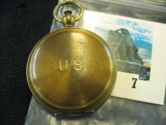 Brass pocketwatch style compass by Waltham with U.S. insignia engraved on case