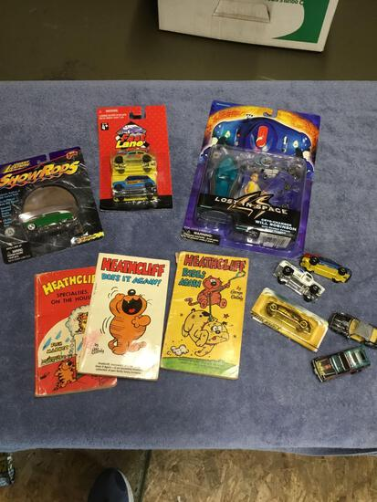 Vintage box of toys to include lost in space figures diecast cars and books