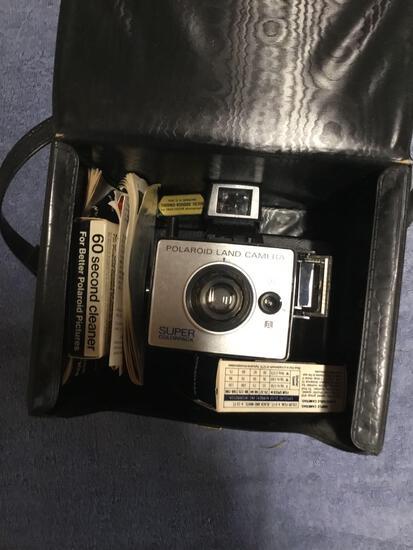 Vintage Polaroid camera in case
