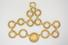 NECKLACE:  [1] 14KYG necklace of woven gold wire mesh style circles and set with one gold Roman coin