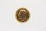 RING:  [1] 18 KYG ring set with a  British Half Sovereign gold coin;  size 10;  56.0 grams