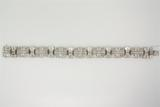 BRACELET:  [1] 14KWG bracelet set with rd and baguette dia.s, TWA 4.70 cts, I/K, SI1-I1; 8½ inches;