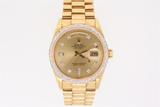 ROLEX: Gents 18ky Rolex O.P. Day Date wristwatch w/ aftermarket diamond appointments, champagne dial