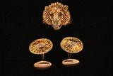 RING:  [1] 10KYG lion's head ring set with 2 rubies and one dia., approx. 0.04 cts, I/J, VS2; size 9