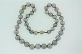 PEARLS:  [1] Strand of 41 graduated black pearls that measure 9.0 to 12.4 mms, light gray in color,