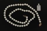 NECKLACE:  [1] single strand necklace (18 in.) of 66 white cultured pearls with rose overtones, 6-6.