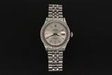 ROLEX: Gents st.steel Rolex O.P. Datejust wristwatch w/ aftermarket diamond bezel, 14kw bezel channe