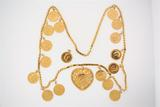 NECKLACE: [1] 18KYG necklace with heart shaped pendant;  the pendant and necklace include 16 gold So