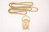 PENDANT: Gents 14ky head of Jesus motif color enhanced yellow & white diamond pendant; eyes w/ 2 mq