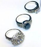 3 Silver Plated Fashion Rings with a pair of crystal berets.