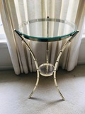 Small glass accent table with metal bamboo style legs