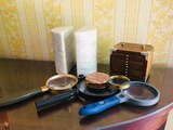 Marble book end magnifying glasses and stack of coasters in wooden case