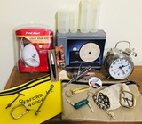 Mix of goodies in Bank Bags, First Alert, Clocks, Steel Balls, Knives, Bank